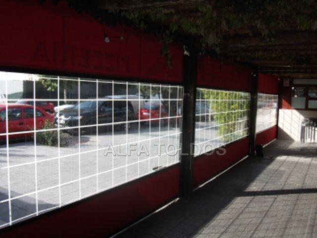 cerramiento para terraza hosteleria con lona acrlica y lona cristal visto desde el interior de